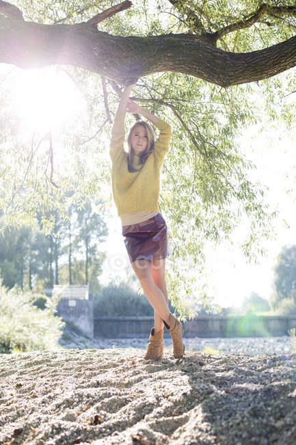 Portrait of young woman wearing knit pullover and mini skirt — Stock Photo