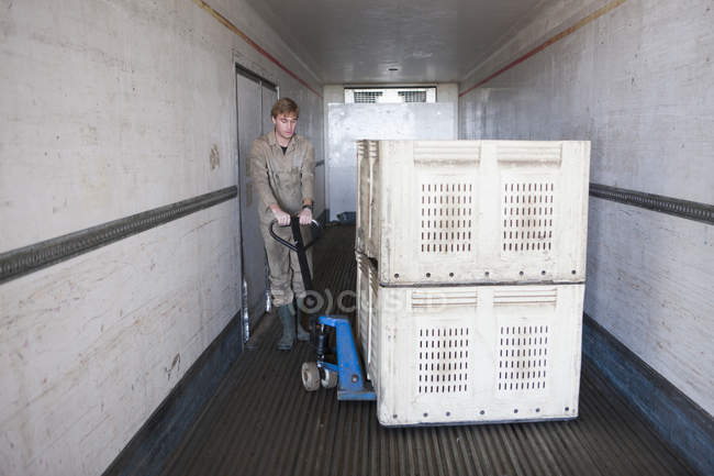 Young Man loading truck — Stock Photo