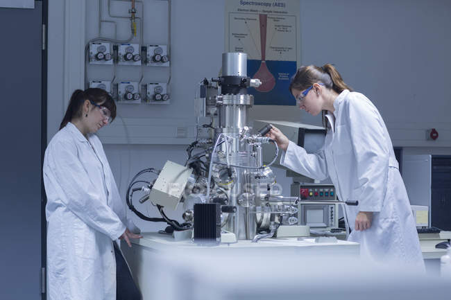 Two female technicans working in a technical laboratory — Stock Photo