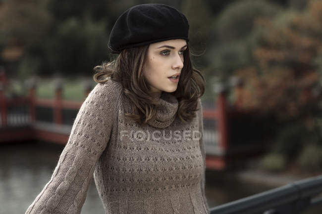 Portrait of young woman wearing beret and knitted dress — Stock Photo