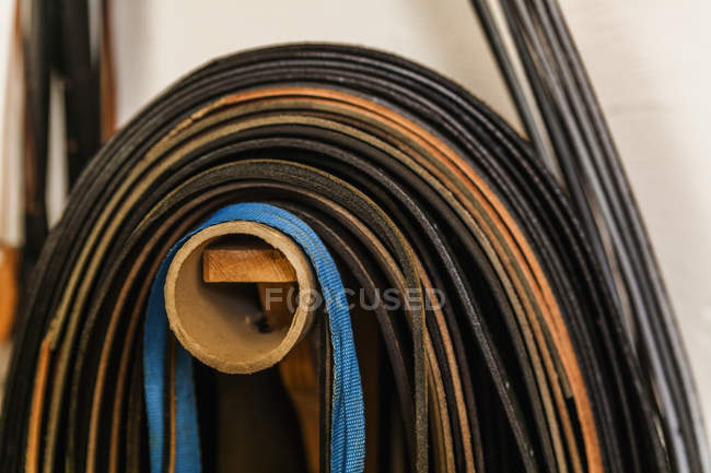 Cut leather straps in saddlery — Stock Photo