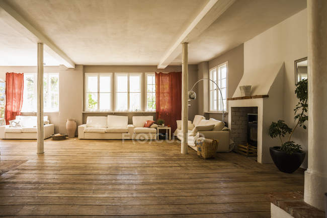 Spacious living room with wooden floor — Stock Photo