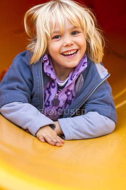 Little girl on chute — Stock Photo