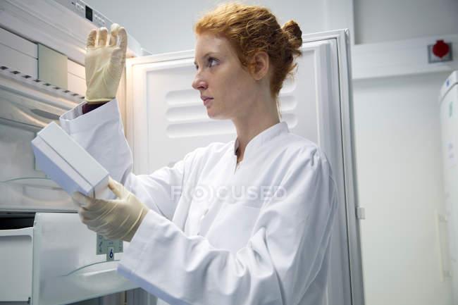 Female natural scientist controlling a test in biochemistry laboratory — Stock Photo