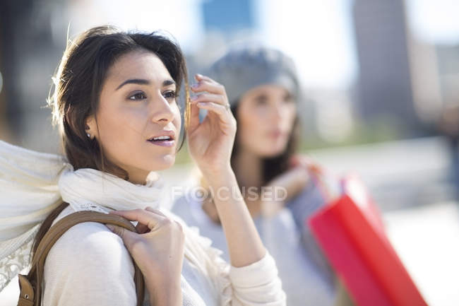 Portrait of surpised woman with white scarf — Stock Photo