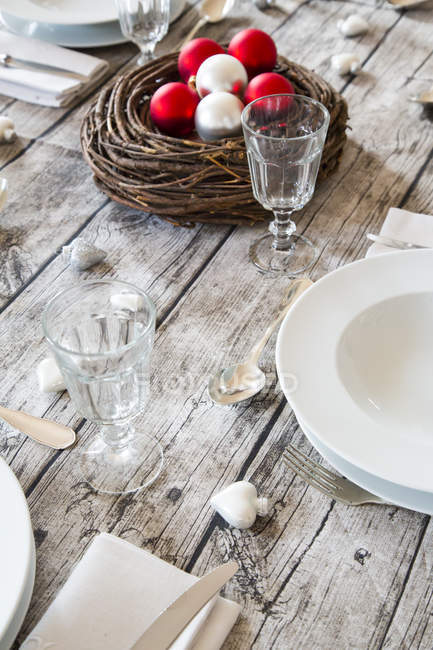 Laid wooden table with Christmas decoration — Stock Photo