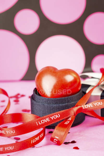 Decoration for Valentine's Day with red ribbon — Stock Photo