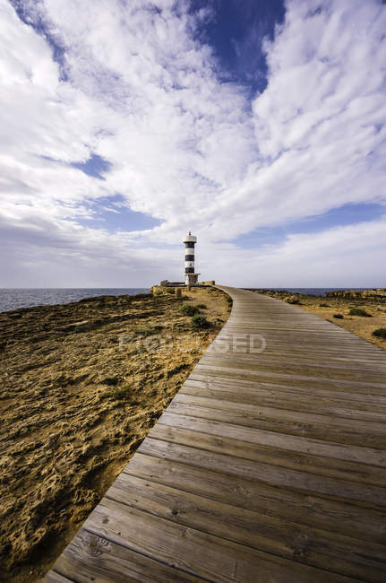 Wooden footpath to Lighthouse — Stock Photo