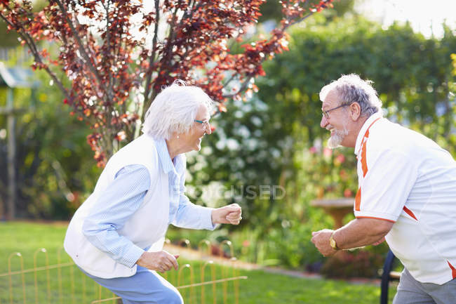 Happy senior couple dancing in park — Stock Photo