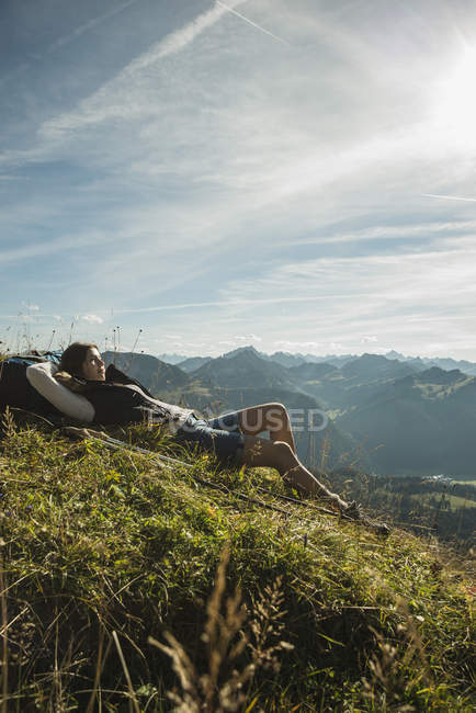 Austria, Tyrol, Tannheimer Tal, young hiker having a rest — Stock Photo