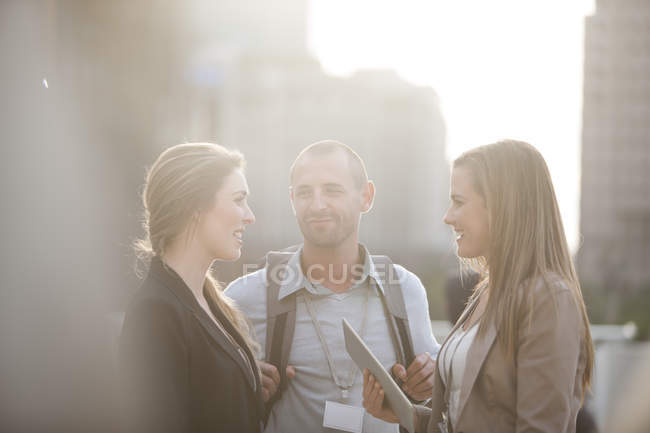 Three colleagues having break time together — Stock Photo