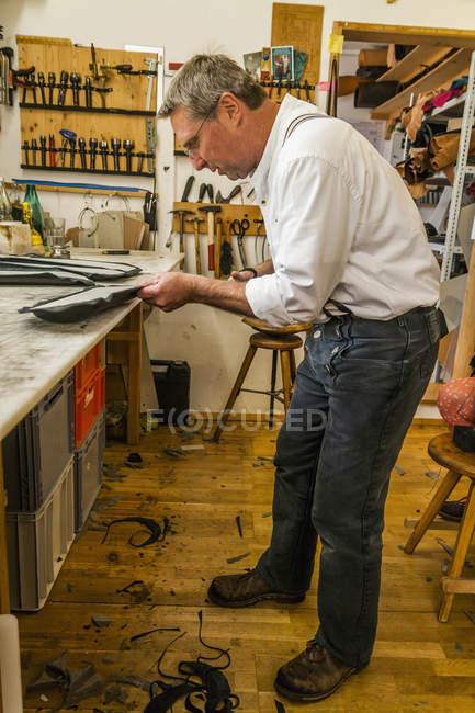 Saddler gluing padding for hippotherapy belt — Stock Photo