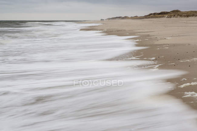 Germany, Schleswig-Holstein, Sylt, waves on sandy beach during daytime — Stock Photo