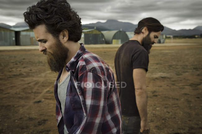 Two men with full beards in abandoned landscape — Stock Photo