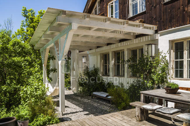 Porch of a country house with trees on foreground — Stock Photo