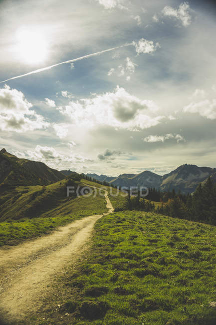 Austria, Tyrol, Tannheimer Tal, hiking trail in mountainscape under clouds — Stock Photo