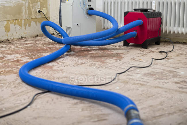 Dehumidifier at work in an apartment which is damaged by flooding — Stock Photo