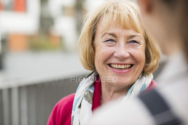 Portrait of smiling blond senior woman — Stock Photo