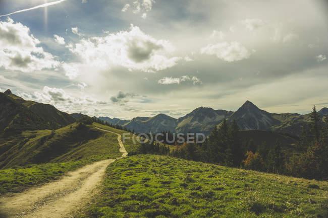 Austria, Tyrol, Tannheimer Tal, hiking trail in mountainscape — Stock Photo