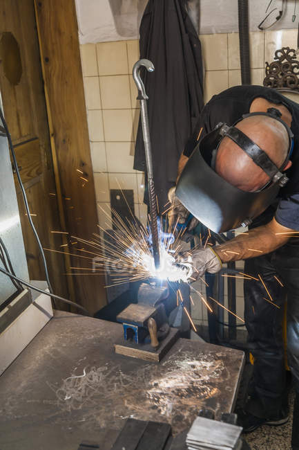 Knife maker welding in workshop at work — Stock Photo