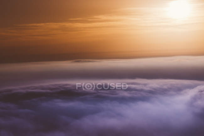 Sunset over the clouds in sky — Stock Photo
