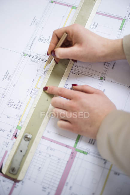Close-up of architect working on construction plan — Stock Photo