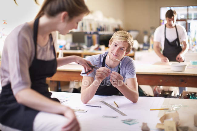 Couple in a workshop manufacturing stained glass — Stock Photo