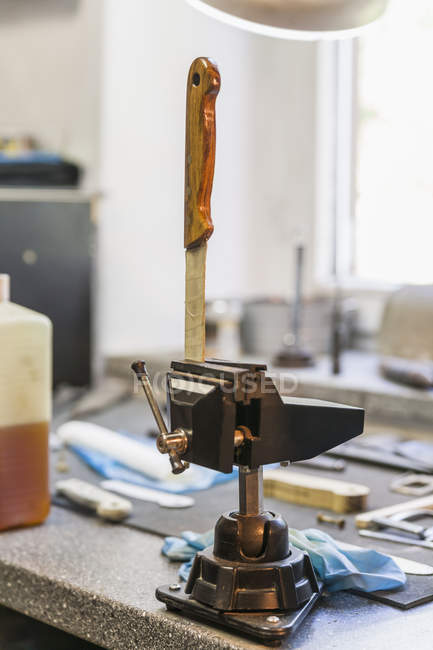 Knife in bench vice in a workshop of a knife maker — Stock Photo