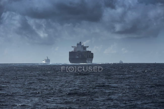 Spain, Andalusia, Tarifa, cargo ships on the ocean — Stock Photo