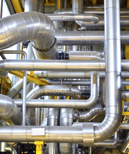 Interior view of modern factory pipework — Stock Photo