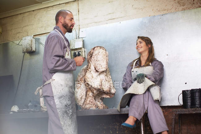 Craftspeople assembling casting mold — Stock Photo
