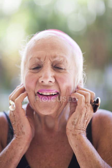 Portrait of optimistic senior woman — Stock Photo