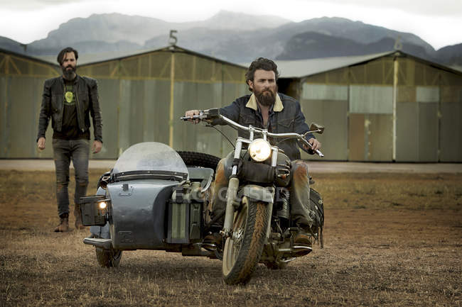 Two men with full beards with motorcycle with sidecar — Stock Photo