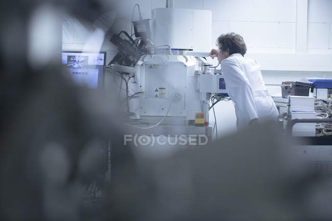 Female technical support specialist working in a technical lab — Stock Photo