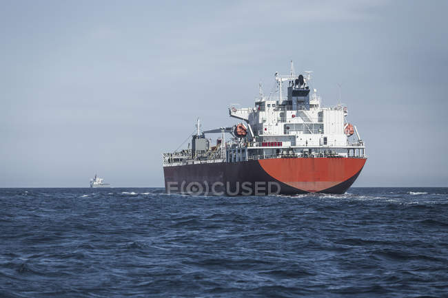 Spain, Andalusia, Tarifa, cargo ship on the ocean — Stock Photo