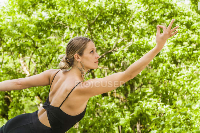 Woman in yoga position — Stock Photo