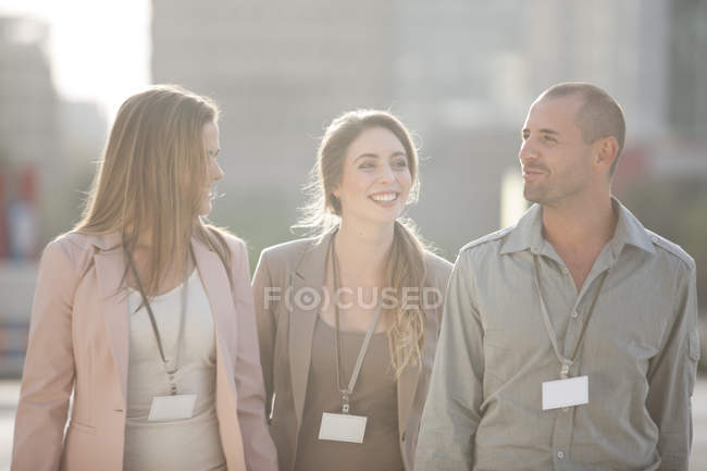 Three colleagues spending break time together — Stock Photo