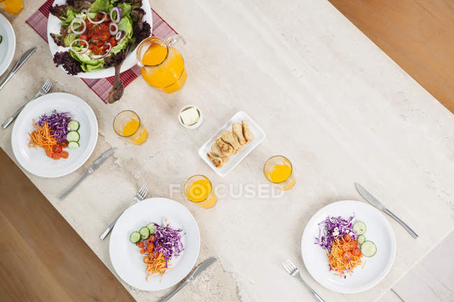 Top view of Salad and juice on dining table — Stock Photo