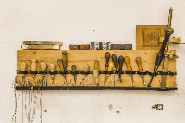 Tools board hanging on wall in saddlery — Stock Photo