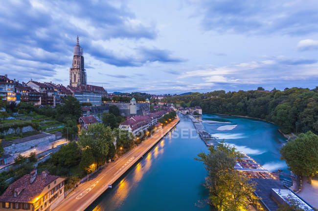 Switzerland, Bern, cityscape with minster and River Aare in the evening light — Stock Photo