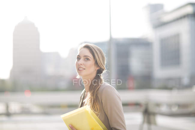 Portrait of businesswoman with file — Stock Photo