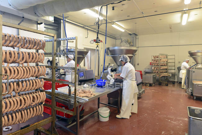Women working at sausage production in a butchery — Stock Photo