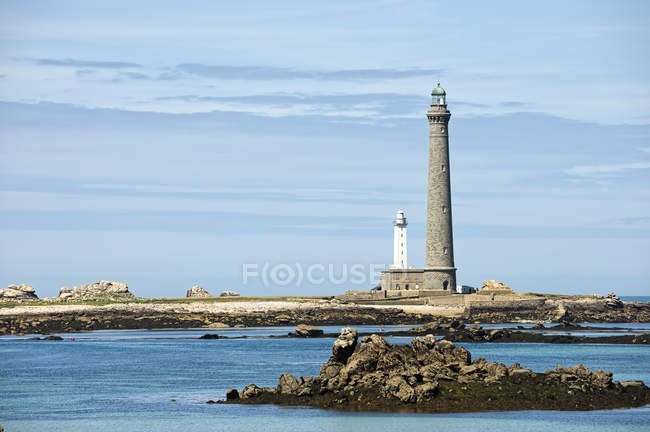 Lighthouse by the coast view — Stock Photo