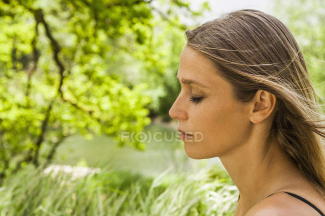 Woman with closed eyes outdoors — Stock Photo