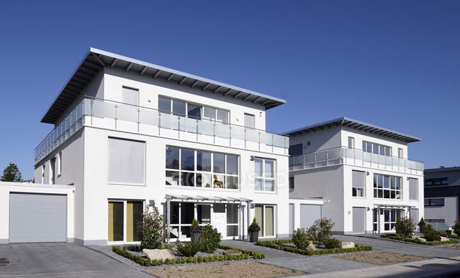 Germany, North Rhine-Westphalia, Moenchengladbach, two newly built apartment houses — Stock Photo