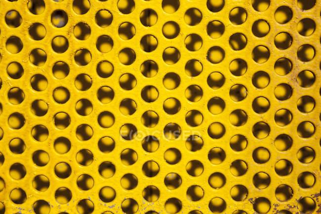Teil der gelben Lochplatte — Stockfoto