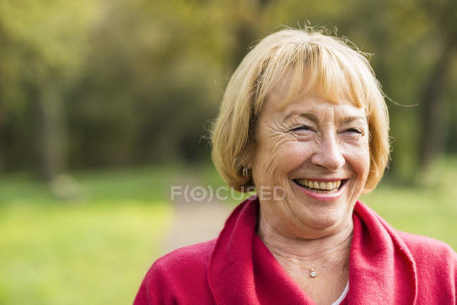 Portrait of laughing blond senior woman — Stock Photo