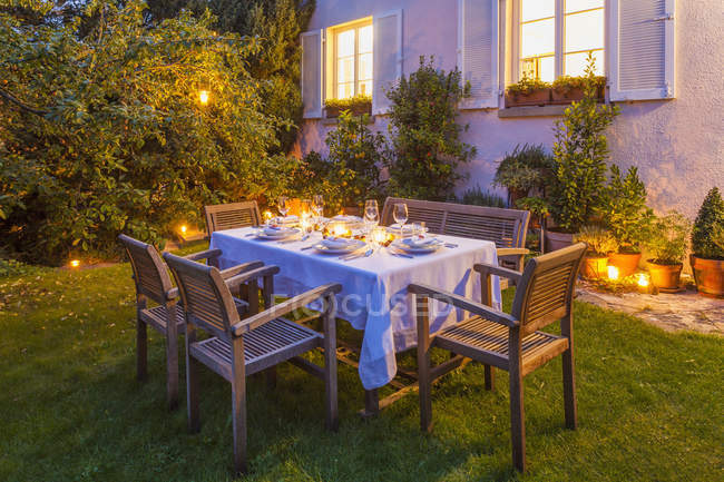 Autumnal laid table in garden in the evening — Stock Photo