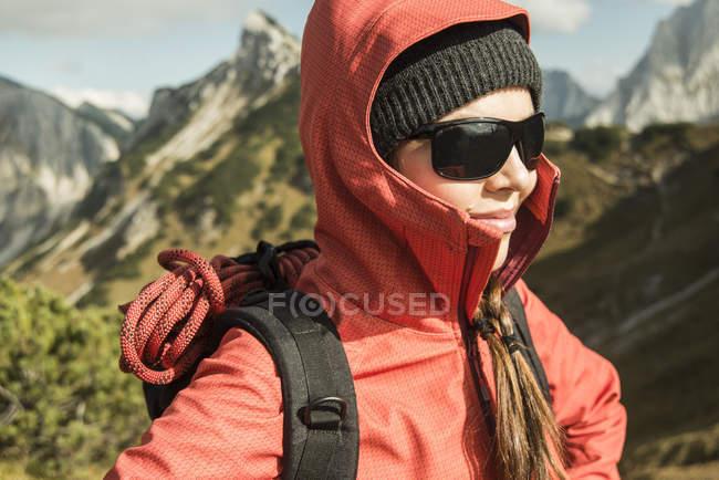 Austria, Tyrol, Tannheimer Tal, female hiker wearing sunglasses — Stock Photo