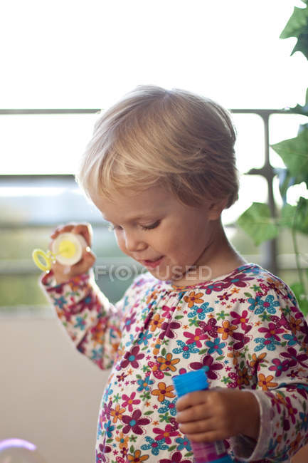 Portrait of little girl with bubble ring — Stock Photo